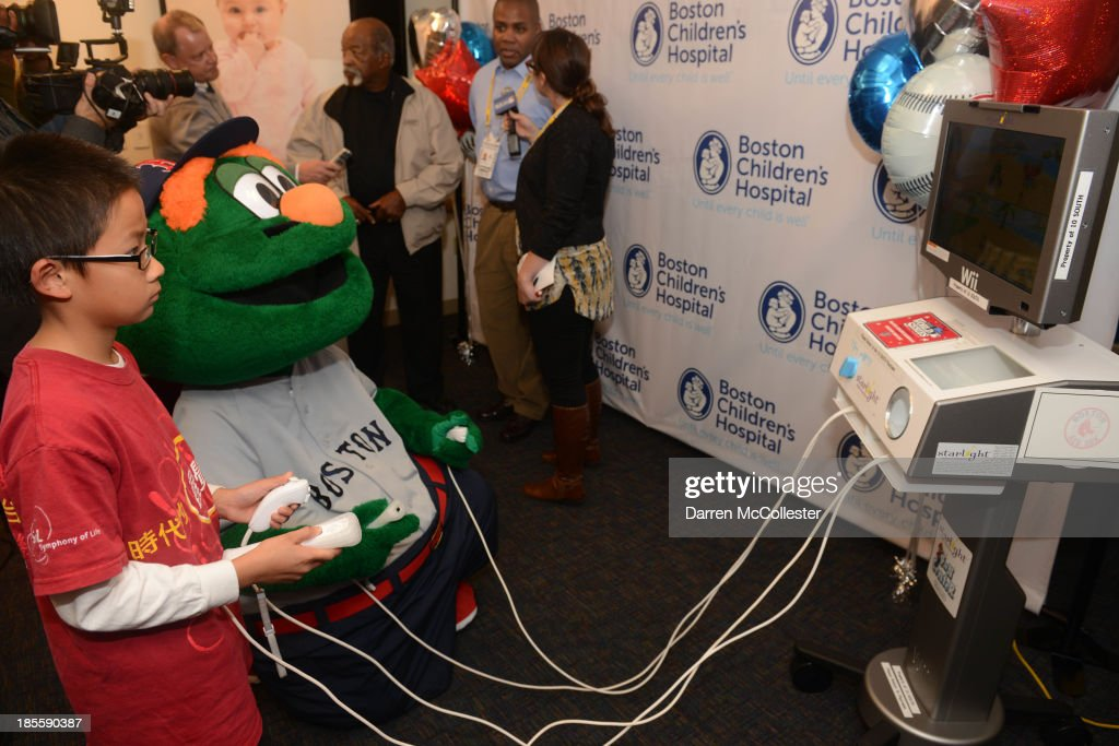 Wally the Green Monster along with MLB, and the Boston Red Sox celebrate World Series with Boston Children's Hospital Starlight Fun Center Donation at Boston Children's Hospital on October 22, 2013 in Boston, Massachusetts.