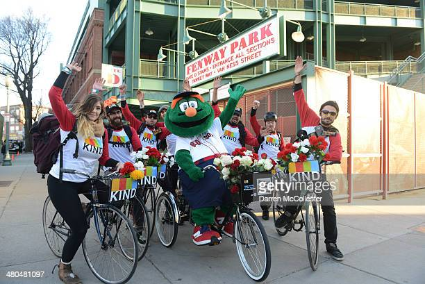 Wally the Green Monster celebrates the Red Sox new partnership with KIND Healthy Snacks, which will bring KIND bars to Fenway Park this season on...