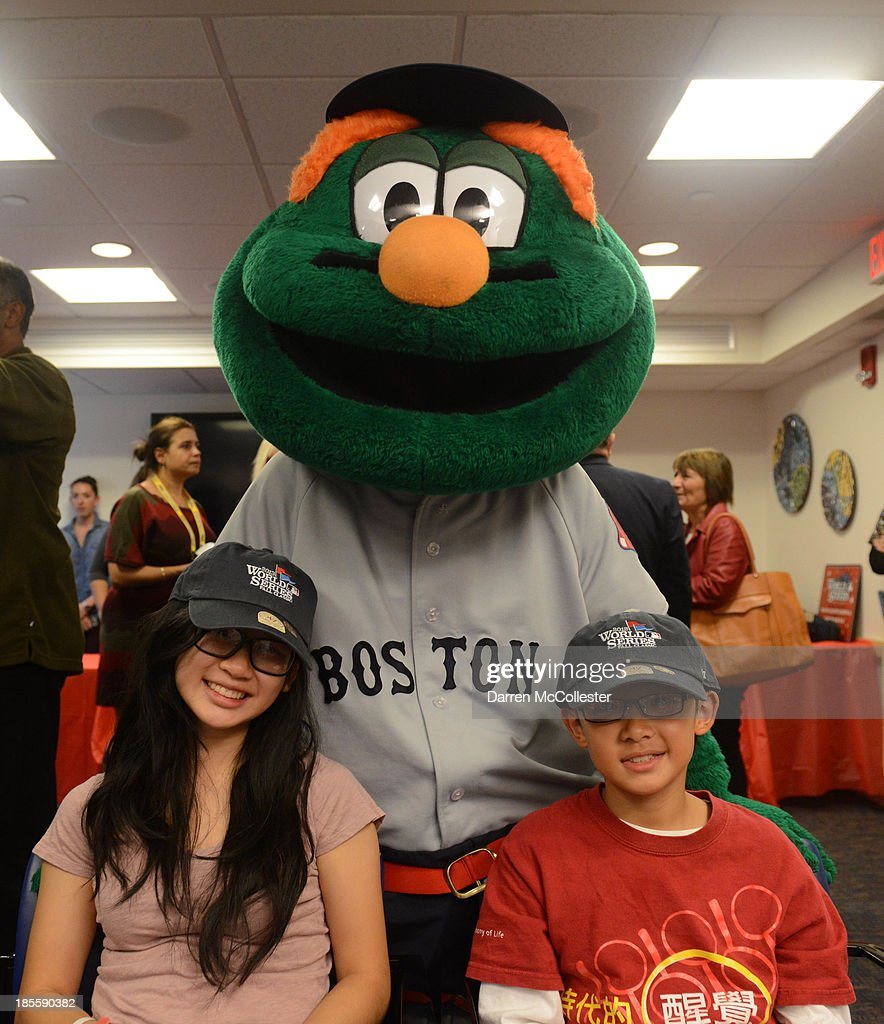 Wally the Green Monster, Grace and brother, along with MLB, and the Boston Red Sox celebrate World Series with Boston Children's Hospital Starlight Fun Center Donation at Boston Children's Hospital on October 22, 2013 in Boston, Massachusetts.