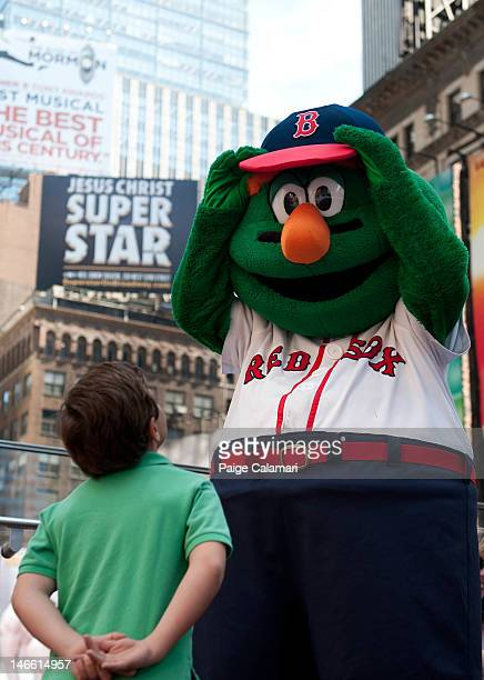 Wally the Green Monster greets a fan in Times Square Tuesday April 17 in New York City