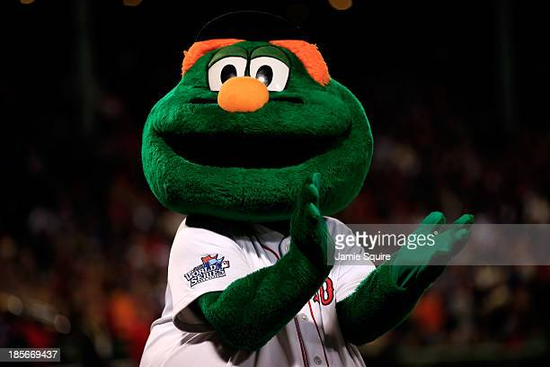 Wally the Green Monster mascot of the Boston Red Sox claps before Game One of the 2013 World Series against the St Louis Cardinals at Fenway Park on...