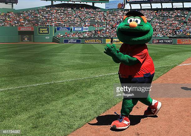 Wally the Green Monster participates in pregame activities before the first game of a doubleheader between the Baltimore Orioles and the Boston Red...