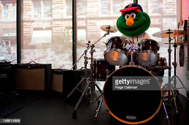 Wally the Green Monster takes a turn on the drums Tuesday April 17 at the MLB Fan Cave located on Broadway and 4th Street in New York City