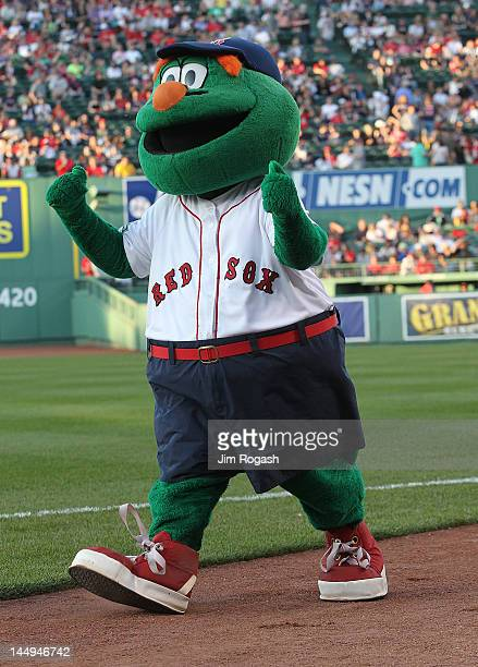 Wally the Green Monster the mascot of the Boston Red Sox walks the fields before a game against the Cleveland Indians at Fenway Park May 12 2012 in...