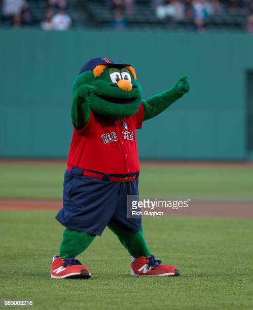 Wally the Green Monster the official mascot of the Boston Red Sox waves to the fans before a game against the Tampa Bay Rays at Fenway Park on May 12...