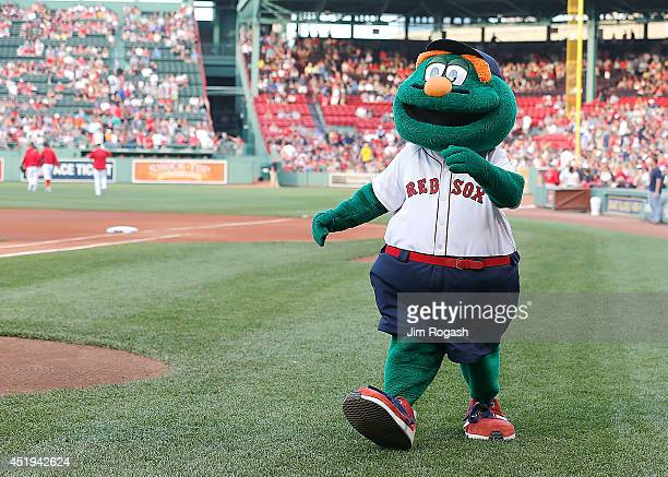 Wally the Green Monster walks around the field before a game between Boston Red Sox and the Chicago White Sox at Fenway Park on July 9 2014 in Boston...