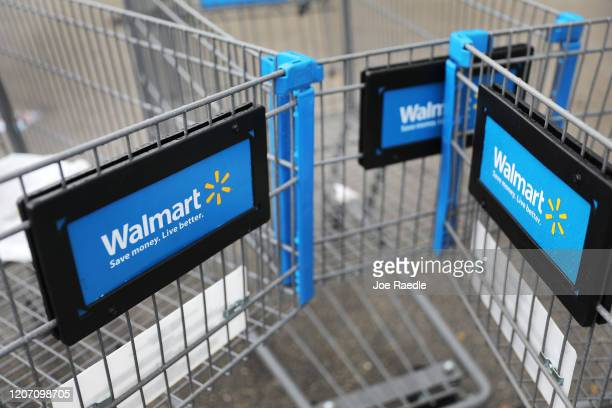 Walmart carts are seen outside of a store as the company reported fiscal fourth-quarter earnings that fell short of analysts' estimates on February...