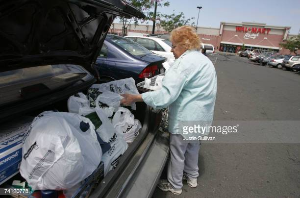 WalMart customer fills her trunk with WalMart purchases May 10 2007 in Oakland California US retailers are reporting slumping samestore sales for the...
