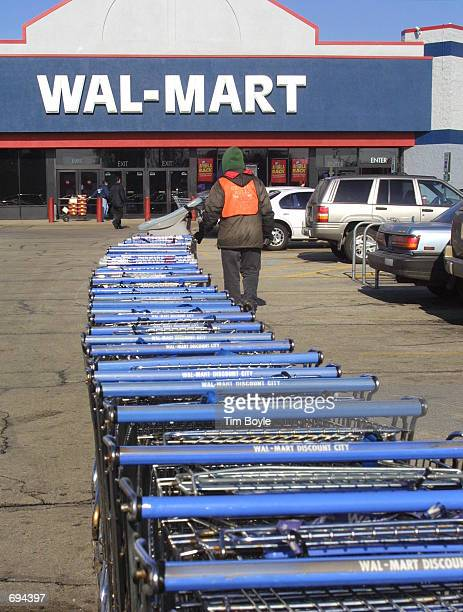 WalMart employee Carl F Heldmaier gathers shopping carts January 24 2002 in Mount Prospect IL WalMart Stores Inc is ready to jump to the top of the...