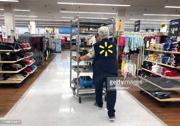 Walmart employee pushes a cart through a Walmart store on August 15, 2019 in Richmond, California. Walmart beat analyst expectations with second...