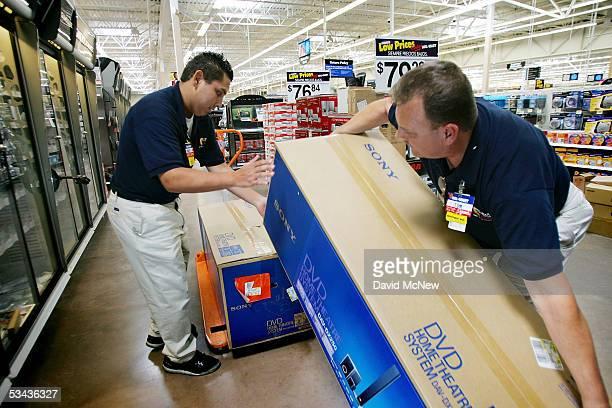 WalMart employees Robert Jimenez and Tom Ondrey stock merchandise at the soontobeopened WalMart Palmdale Supercenter department store on August 18...