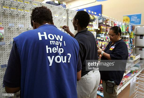 WalMart employees stock items in a new 142000 square foot WalMart store on September 26 2006 in Chicago Illinois the day before it opens on September...