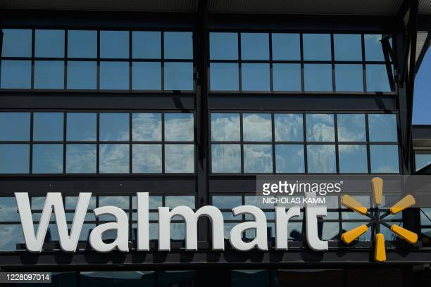 Walmart logo is seen outside a store in Washington, DC, on August 18, 2020. - Walmart saw its profits jump in latest quarter as e-commerce sales...
