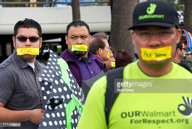 WalMart Stores Inc current and former employees demonstrate outside the Yahoo Inc annual shareholders meeting in Santa Clara California US on Tuesday...