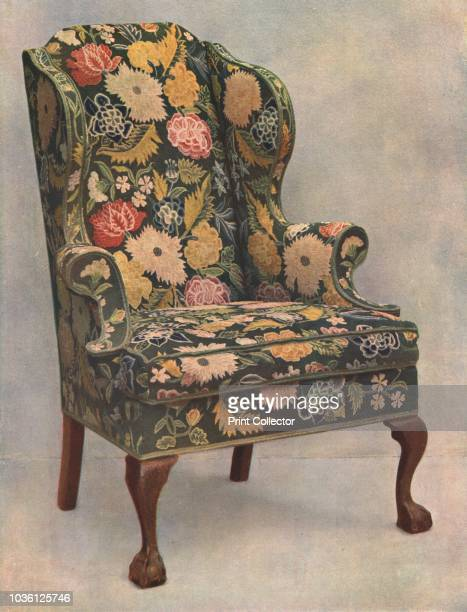 Walnut chair covered with needlework, 1905. Print from A History of English Furniture, the Age of Walnut by Percy Macquoid R.I. [T&A Constable,...