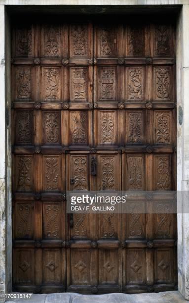 Walnut wood main entry door created by sculptor Matteo Sanmicheli circa 151828 facade of Casa Cavassa Saluzzo Piedmont Italy