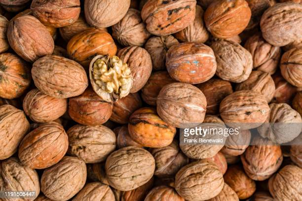 Walnuts are offered for sale inside the Spice Bazaar Msr Çars also known as Egyptian Bazaar