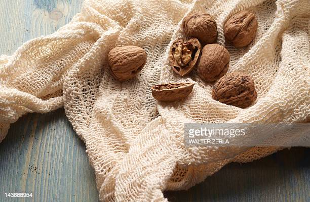 Walnuts in knitted fabric on table