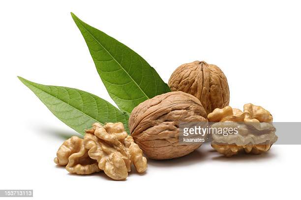 Walnuts with leaves isolated on white background