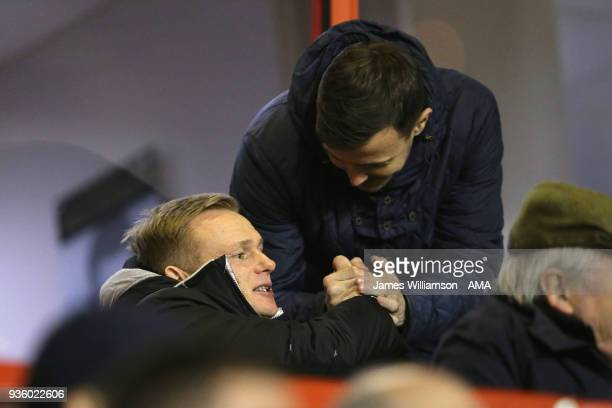 Walsall fan greets new Walsall manager Dean Keates during the Sky Bet League One match between Wigan Athletic and Walsall at Banks' Stadium on March...
