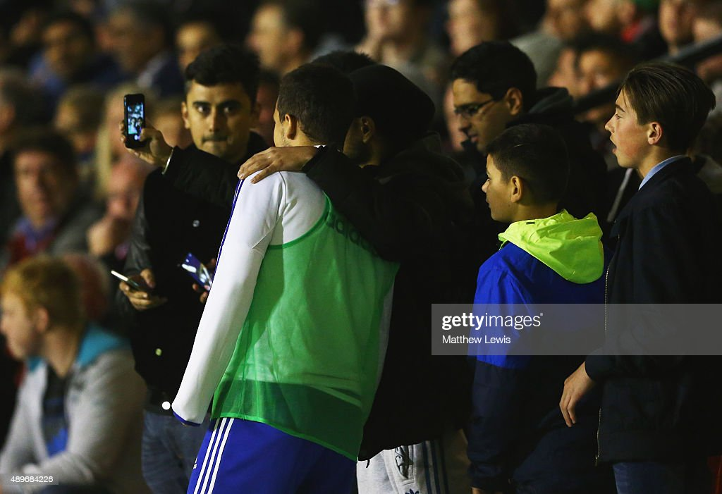 Walsall fans pose for a selfie photograph with substitute Eden Hazard of Chelsea during the Capital One Cup third round match between Walsall and Chelsea at Banks's Stadium on September 23, 2015 in Walsall, England.