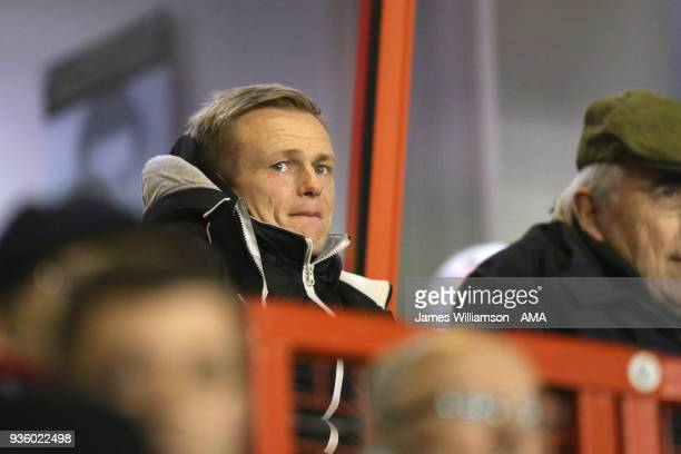 Walsall manager Dean Keates watches on from the crowd during the Sky Bet League One match between Wigan Athletic and Walsall at Banks' Stadium on...