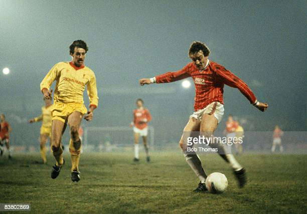 Walsall striker Alistair Brown shoots watched by Liverpool defender Mark Lawrenson during their League Cup SemiFinal 2nd leg sponsored by the Milk...
