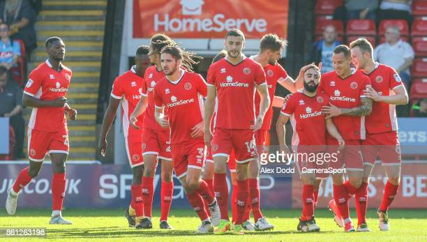 Walsall's Erhun Oztumer celebrates scoring his side's first goal with teammates during the Sky Bet League One match between Walsall and Blackpool at...