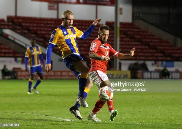 Walsall's Milan Lalkovic and Shrewsbury Town's Jack Grimmer battle for the ball