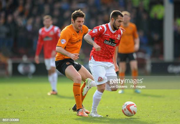 Walsall's Milan Lalkovic and Wolverhampton Wanderers' Sam Ricketts battle for the ballduring the Sky Bet League One match at Banks's Stadium Walsall
