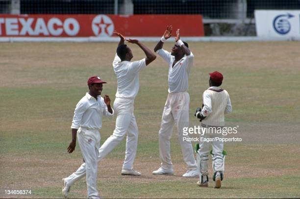 Walsh and Ambrose celebrate the dismissal of Kirsten ; also in pic Brian Lara and David Williams, West Indies v South Africa, 1st Test, Bridgetown,...