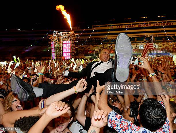 Walshy Fire of Major Lazer surfs the crowd as he performs at the 17th annual Electric Daisy Carnival at Las Vegas Motor Speedway on June 23 2013 in...