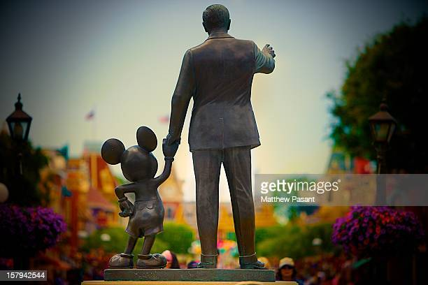 Walt and Mickey look onto the crowds coming down Main Street USA.