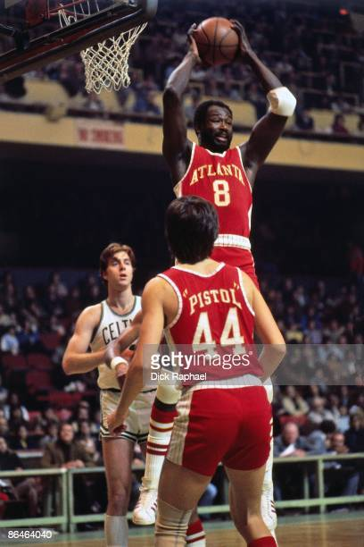 Walt Bellamy of the Atlanta Hawks rebounds against the Boston Celtics during a game played in 1974 at the Boston Garden in Boston Massachusetts NOTE...