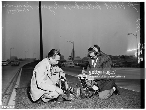 Walt Bilicke and Eugene Spencer checking radioactivity levels on freeway over Beaudry street where count was 66 per second of gamma radiation
