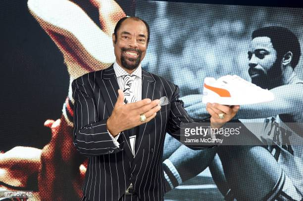 "Walt ""Clyde"" Frazier signs the first ever life long contract with PUMA at the PUMA Hoops HQ kickoff on June 18, 2018 in Brooklyn."