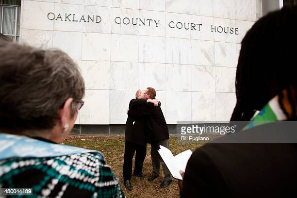 Walt Crisdale and Mark Rabchun of Pleasant Ridge MI get married at the Oakland County Courthouse on March 22 2014 in Pontiac Michigan A Federal judge...