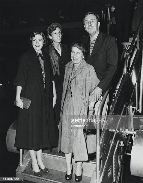 Walt Disney and his rarely photographed family arrived today from Los Angeles aboard an American Airlines flagship Mr Disney leaves for England...