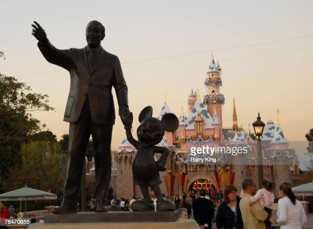 Walt Disney and Mickey Mouse Statue at Disneyland's Sleeping Beauty's Holiday Castle and Believe In Holiday Magic Fireworks spectacular held at...