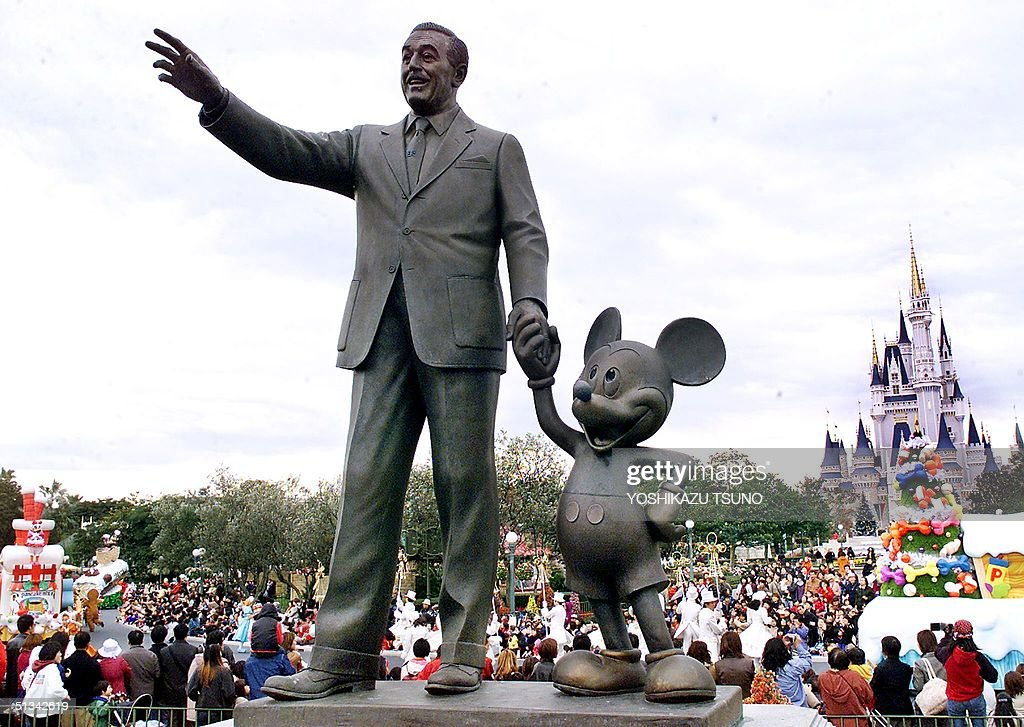 Walt Disney and Mickey Mouse statues stand at the : News Photo