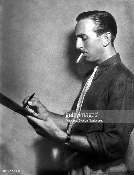 Walt Disney animator entrepreneur designer filmmaker voice actor and American film producer portrayed in profile while drawing on a sketch pad...