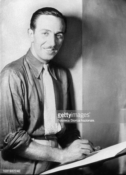 Walt Disney animator entrepreneur designer filmmaker voice actor and American film producer portrayed while drawing on a sketch pad Portrait by...