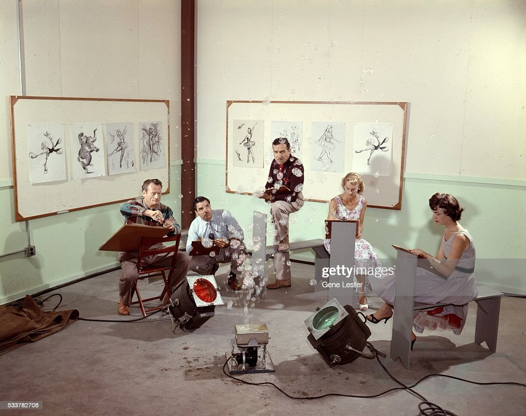 Walt Disney animators sketching together at Disneyland in circa 1955 in Anaheim, California.