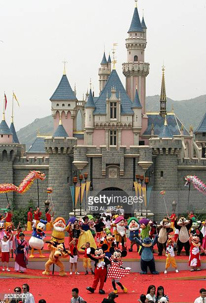 Walt Disney characters Mickey and Minnie Mouse wave during the opening ceremony of Hong Kong Disneyland theme park 12 September 2005 Disney...