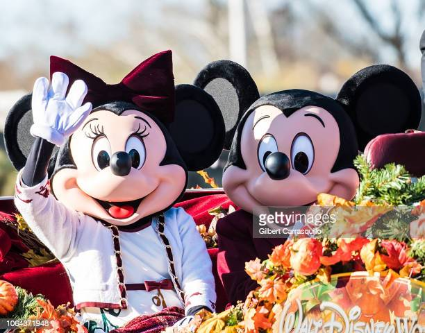 Walt Disney characters Minnie Mouse and Mickey Mouse attend the 99th Annual 6abc Dunkin' Donuts Thanksgiving Day Parade on November 22 2018 in...