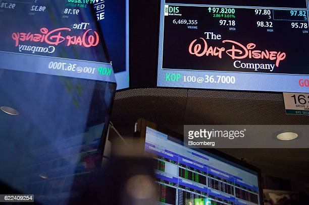 Walt Disney Co signage is displayed on the floor of the New York Stock Exchange in New York US on Friday Nov 11 2016 US stocks fluctuated in whipsaw...