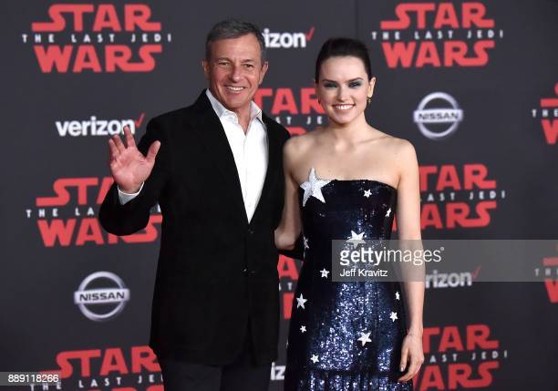 Walt Disney Company Chairman/CEO Robert Iger and Daisy Ridley attend the premiere of Disney Pictures and Lucasfilm's 'Star Wars The Last Jedi' at The...