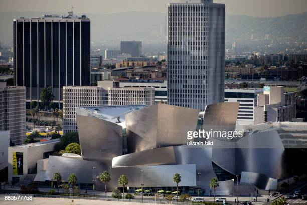 Walt Disney Concert Hall in Los Angeles next to skyscrapers view from City Hall