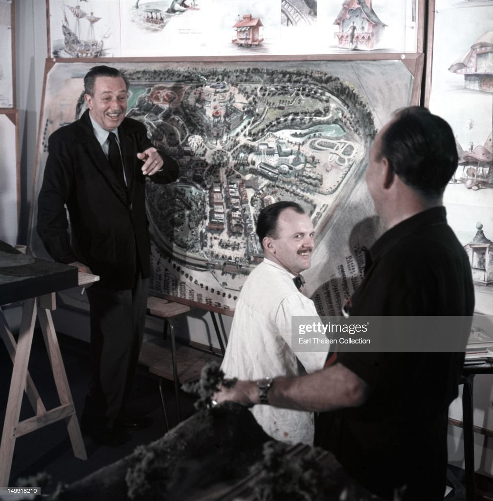 Walt Disney stands by a plan of Disneyland and chats with some imagineers circa 1954 in Los Angeles, California.