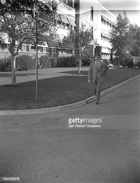 Walt Disney strolls down Dopey drive on the Disney Studio backlot circa 1945 in Los Angeles California